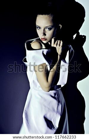 portrait fashion women with deep shadows on face red lips abstract background - stock photo