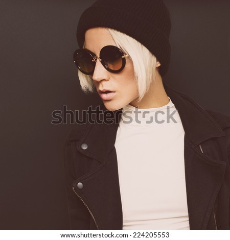 Portrait fashionable Blonde on a black background. Autumn style Hat and Sunglasses - stock photo