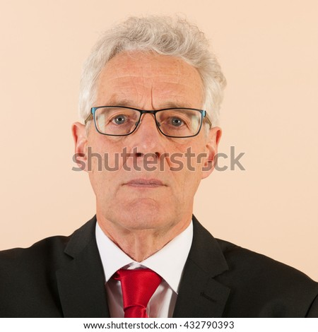 Portrait Formally dressed Senior business man with neck tie - stock photo