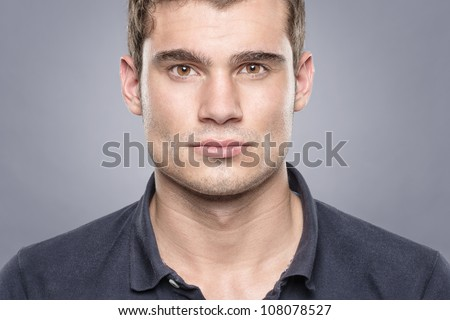 Portrait from a sportsman in front of blue background - stock photo