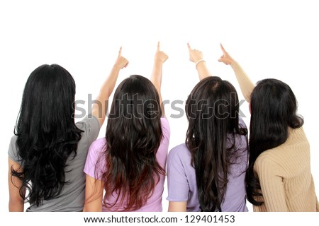 portrait group of woman pointing into white background - stock photo