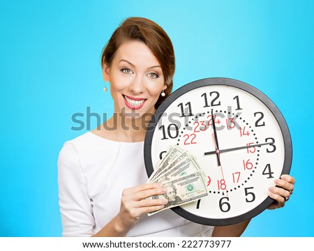 Portrait happy business woman, financial adviser corporate employee ceo holding wall clock dollar bills in hands. Time is money concept isolated blue background. Positive human emotion face expression - stock photo