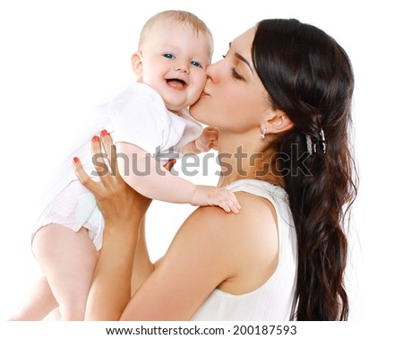 Portrait happy mother holds and kissing her baby - stock photo