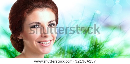 Portrait happy smiling healthy woman on a spring abstract nature background - stock photo