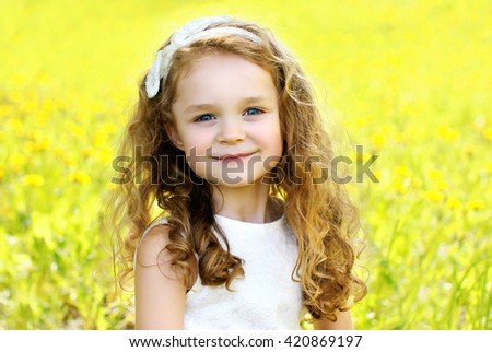 Portrait happy smiling little girl child outdoors in sunny summer day - stock photo