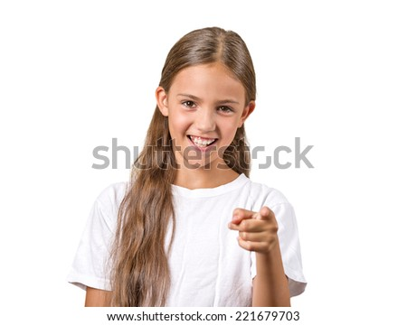 Portrait happy teenager girl pointing finger laughing smiling surprised by something isolated on white background. Positive human emotion facial expression feeling reaction body language - stock photo