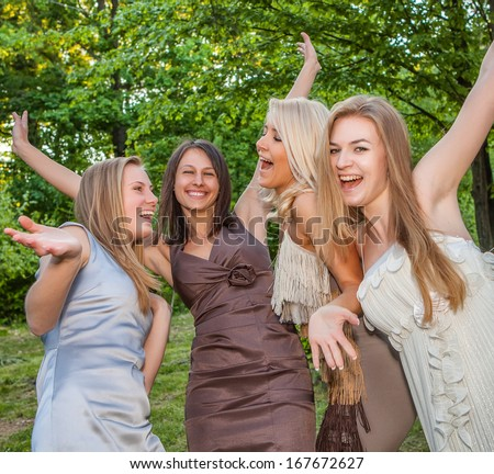 Portrait happy young and attractive girlfriends - stock photo