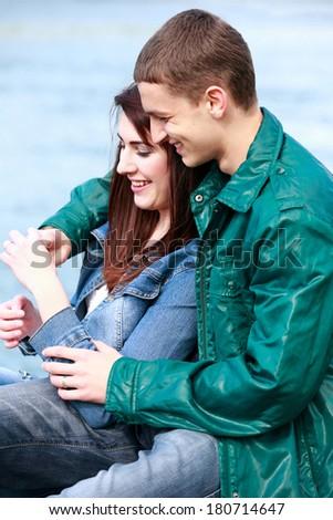 Portrait happy young teenage couple outdoor - stock photo