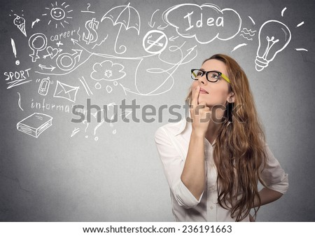 Portrait happy young woman thinking dreaming has many ideas looking up isolated grey wall background. Positive human face expression emotion feeling life perception. Decision making process concept.  - stock photo