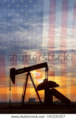 Portrait image of a oil well pumpjack wiith an early morning golden sunrise and American USA red White and Blue Flag background. - stock photo