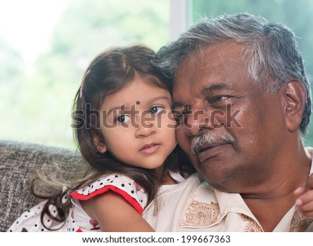 Portrait Indian family at home. Grandparent and grandchild close up face. Asian people living lifestyle. Grandfather and granddaughter. - stock photo