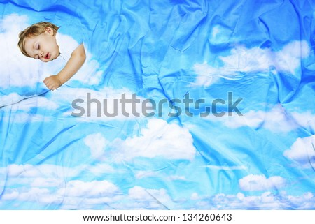 portrait infant lying on the bed out of the sky and clouds - stock photo