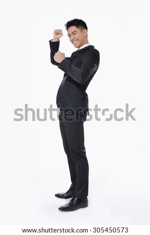 Portrait: Isolated successful young smart businessman cheering and happy - stock photo