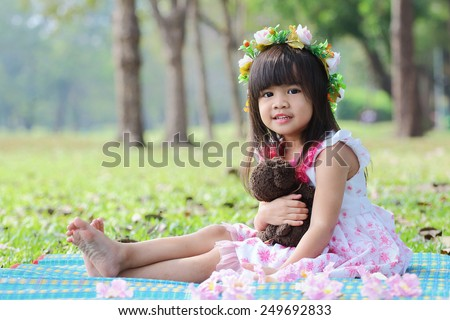 Portrait, Little asian girl was playing happily in the park - stock photo