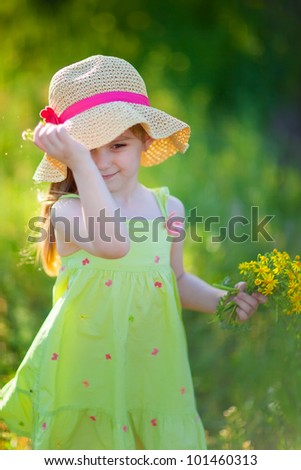 Portrait lovely girl in white with camomiles - stock photo
