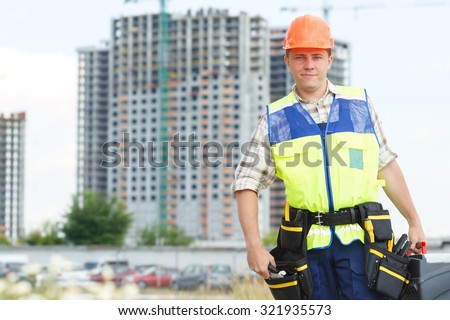 Portrait man construction worker. Male engineer construction. Contractor at a building site. Male construction worker at a building site. Business construction. Place for advertisement message.  - stock photo