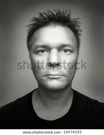portrait man shoot on wide angle lens on gray background - stock photo