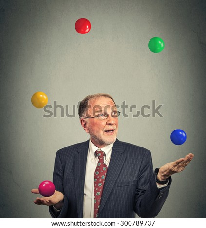 Portrait mature business man juggling multitasking  - stock photo