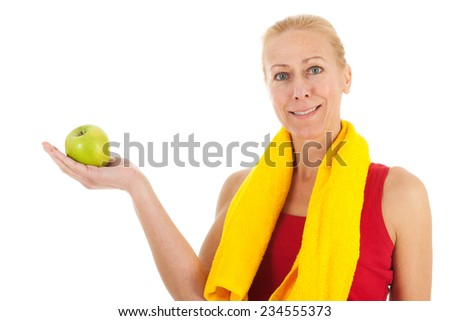 Portrait mature woman in fitness clothing with apple isolated over white background - stock photo