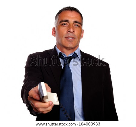 Portrait of a adult charismatic broker offering a telephone against white background - stock photo