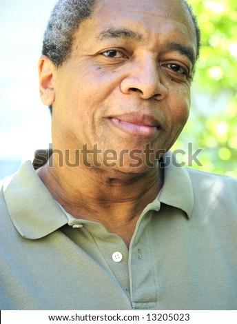 Portrait of a african american male outdoors in a park on a summer day. - stock photo
