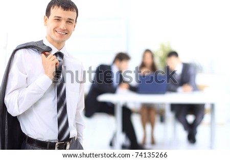 Portrait of a ambitious business man in an office environmen - stock photo