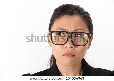 Portrait of a angry Asian Business woman looking to side. - stock photo