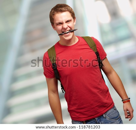 Portrait Of A Angry Young Man, Background - stock photo