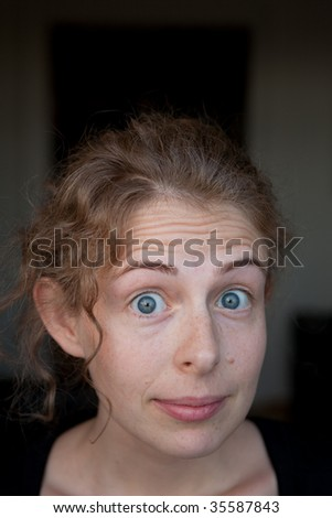 portrait of a astonished young woman in natural beauty - stock photo
