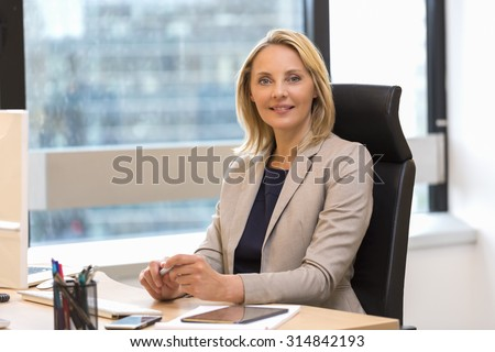 Portrait of a attractive business woman at office - stock photo
