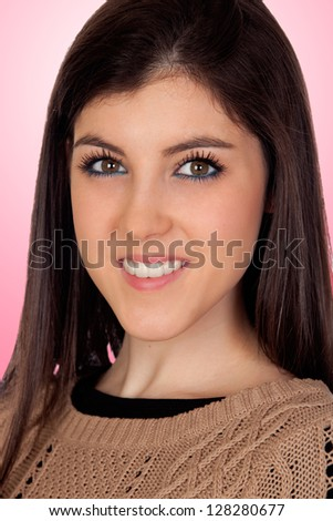 Portrait of a attractive girl isolated on pink background - stock photo