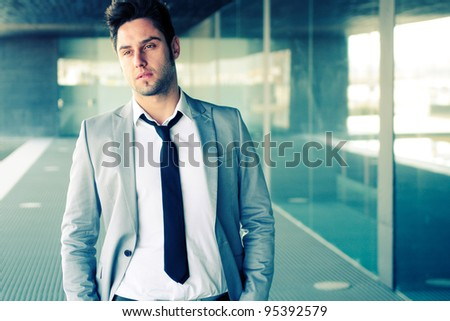 Portrait of a attractive young businessman in office building - stock photo