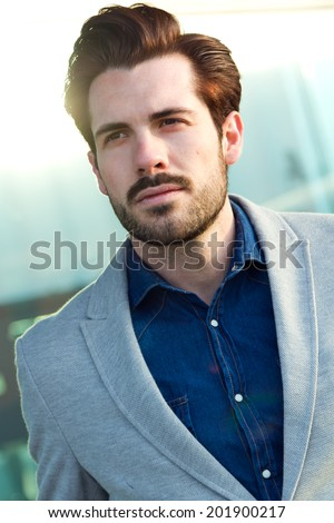 Portrait of a attractive young businessman outside in airport - stock photo