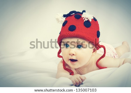 Portrait of a baby in a hat - stock photo