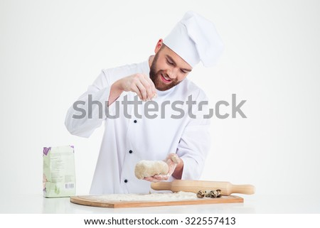 Portrait of a baker preparing dough for pastry isolated on a white background - stock photo