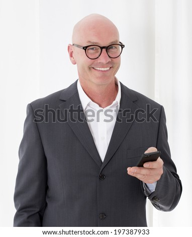 portrait of a bald-headed man being on the phone - stock photo