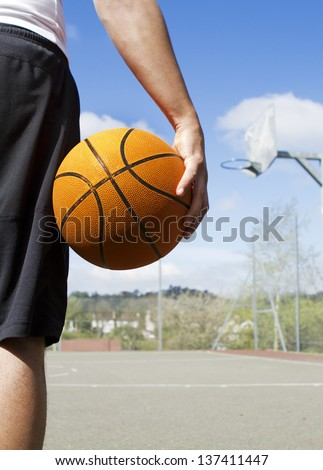 Portrait of a Basketball Player holding a basketball - stock photo