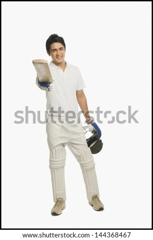 Portrait of a batsman celebrating his success - stock photo