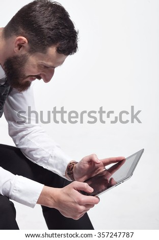 Portrait of a bearded business man using a tablet. On white background. - stock photo