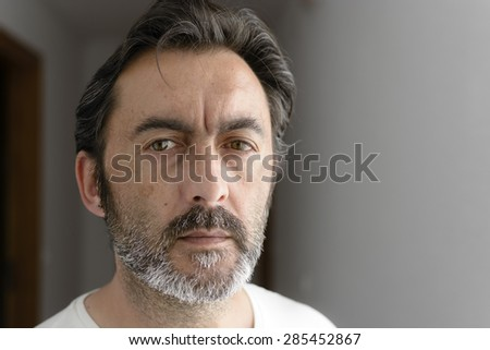 Portrait of a bearded man looking at camera. Selective focus. - stock photo