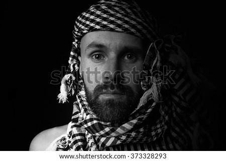 portrait of a bearded man wearing a hijab - stock photo