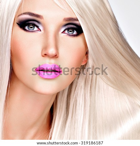 Portrait of  a  beautiful adult woman with long white straight  hairs.  Face of a Fashion model with pink lipstick. Pretty girl posing at studio. - stock photo