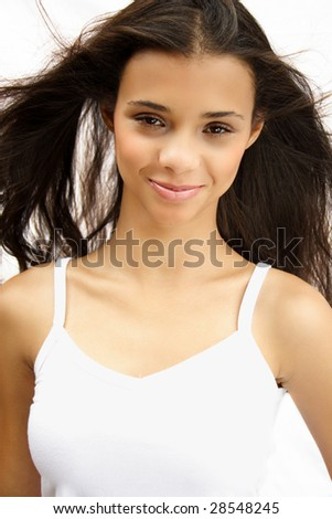 Portrait of a beautiful african american long hair girl - stock photo