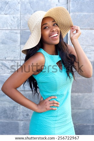 Portrait of a beautiful african american woman smiling with sun hat - stock photo
