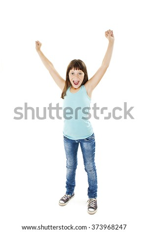 Portrait of a beautiful and confident girl with arms on the air. Isolated on white background. Excited little girl celebrates  - stock photo