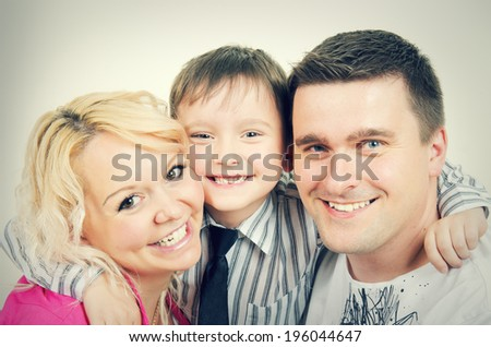 Portrait of a beautiful and happy family - stock photo