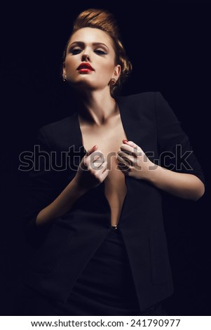 Portrait of a beautiful and sensual girl in the studio on a black background - stock photo