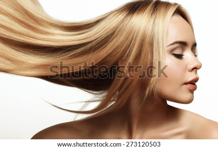 portrait of a beautiful and young blonde with long groomed hair - stock photo