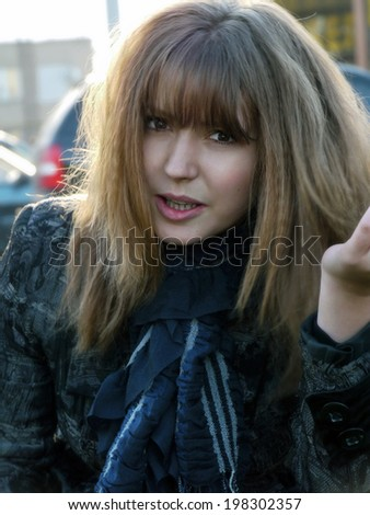 Portrait of a beautiful, angry girl, close-up. - stock photo