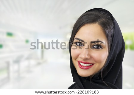 Portrait of a beautiful Arabian Woman wearing Hijab, Arabian Businesswoman wearing Hijab   - stock photo